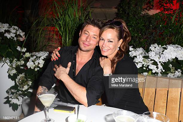 Duncan James and Tara PalmerTomkinson attend a party for the closing night of the Olympics at Omega House on August 12 2012 in London England