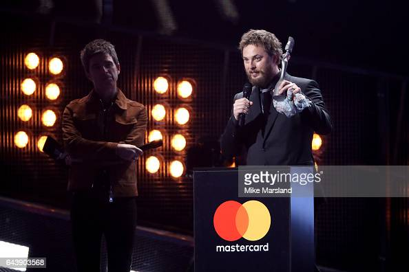 Duncan Jones receives the Mastercard British Album of the Year award on belhalf of his father David Bowie from Noel Gallagher on stage at The BRIT...