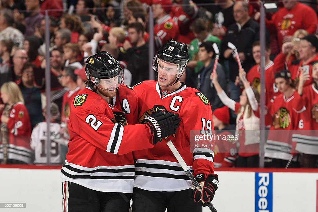 <a gi-track='captionPersonalityLinkClicked' href=/galleries/search?phrase=Duncan+Keith&family=editorial&specificpeople=4194433 ng-click='$event.stopPropagation()'>Duncan Keith</a> #2 and <a gi-track='captionPersonalityLinkClicked' href=/galleries/search?phrase=Jonathan+Toews&family=editorial&specificpeople=537799 ng-click='$event.stopPropagation()'>Jonathan Toews</a> #19 of the Chicago Blackhawks celebrate after Toews scored the game winning goal in overtime against the San Jose Sharks to give the Blackhawks a 4 to 3 victory during the NHL game at the United Center on December 20, 2015 in Chicago, Illinois.