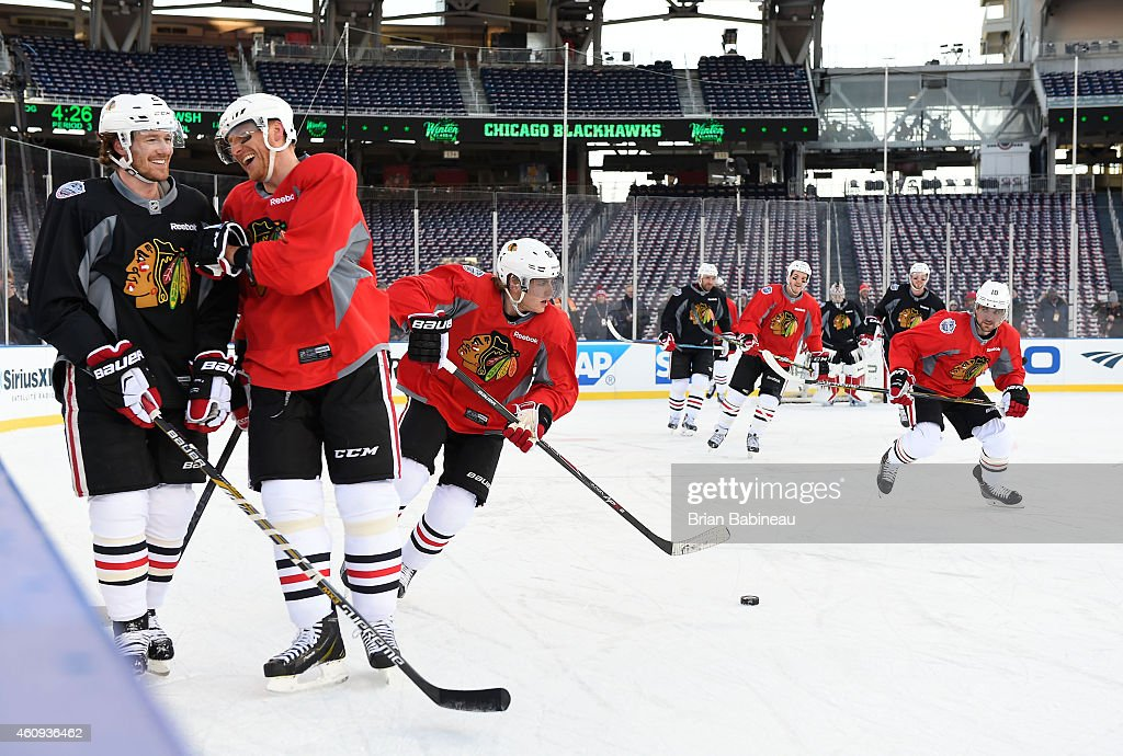 <a gi-track='captionPersonalityLinkClicked' href=/galleries/search?phrase=Duncan+Keith&family=editorial&specificpeople=4194433 ng-click='$event.stopPropagation()'>Duncan Keith</a> #2 and <a gi-track='captionPersonalityLinkClicked' href=/galleries/search?phrase=Marian+Hossa&family=editorial&specificpeople=202233 ng-click='$event.stopPropagation()'>Marian Hossa</a> #81 of the Chicago Blackhawks share a laugh as teammates <a gi-track='captionPersonalityLinkClicked' href=/galleries/search?phrase=Patrick+Kane&family=editorial&specificpeople=1977261 ng-click='$event.stopPropagation()'>Patrick Kane</a> #88 and <a gi-track='captionPersonalityLinkClicked' href=/galleries/search?phrase=Patrick+Sharp&family=editorial&specificpeople=206279 ng-click='$event.stopPropagation()'>Patrick Sharp</a> #10 skate with the puck during practice day prior to the 2015 Bridgestone NHL Winter Classic on December 31, 2014 in Washington, D.C. The 2015 Bridgestone NHL Winter Classic will take place on New Year's Day with the Washington Capitals playing the Chicago Blackhawks.