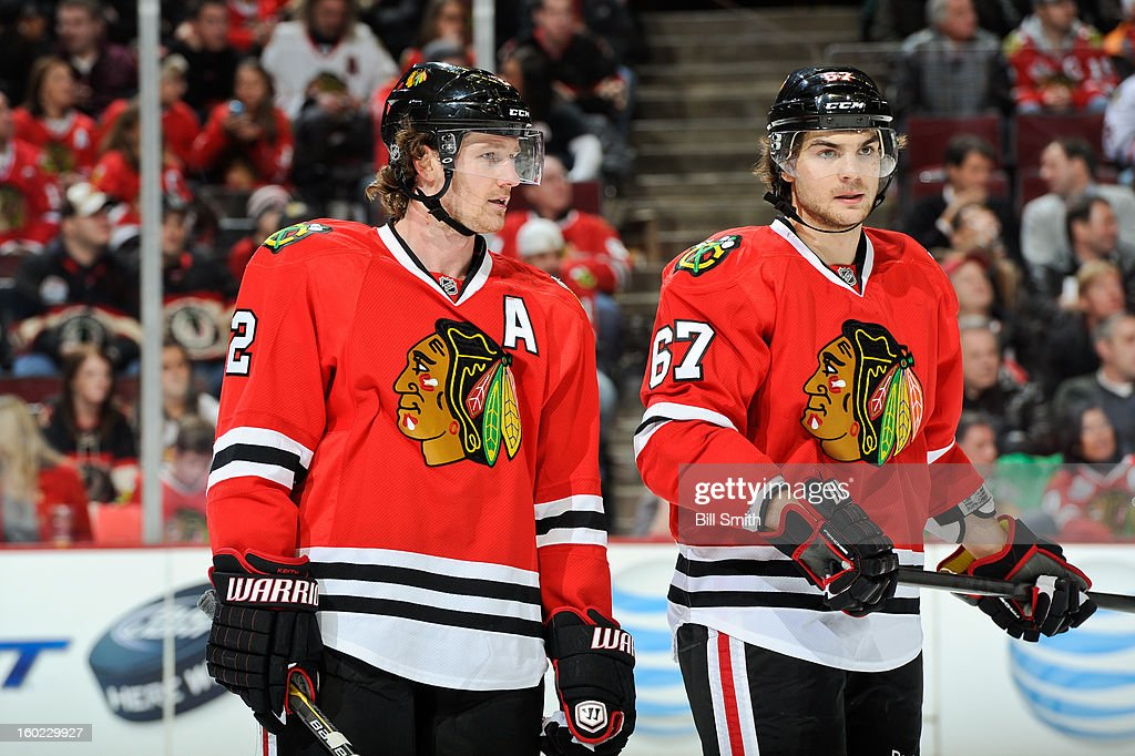 Duncan Keith #2 and Michael Frolik #67 of the Chicago Blackhawks converse during the NHL game against the St. Louis Blues on January 22, 2013 at the United Center in Chicago, Illinois.