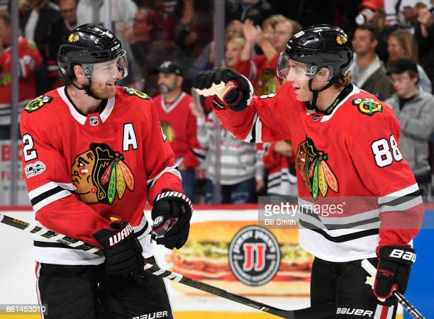 Duncan Keith and Patrick Kane of the Chicago Blackhawks celebrate after defeating the Nashville Predators 21 in overtime at the United Center on...