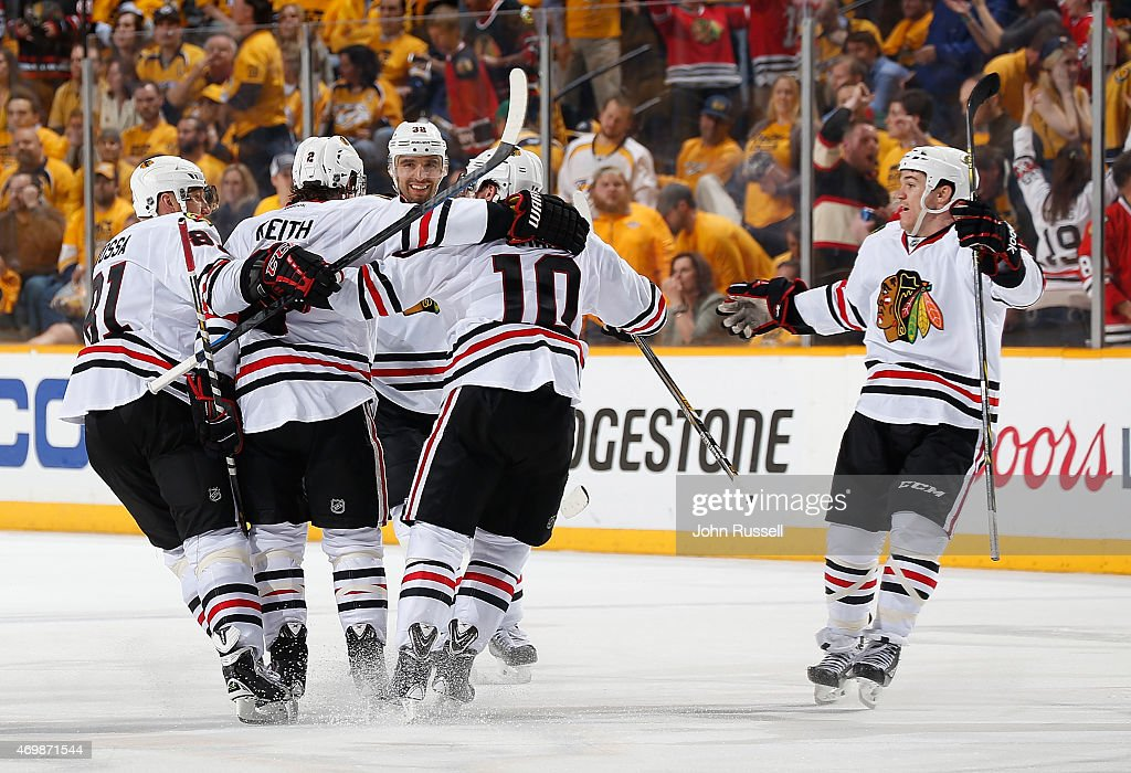 Duncan Keith #2 celebrates his game winning goal with Marian Hossa #81 and Patrick Sharp #10 of the Chicago Blackhawks against the Nashville Predators in the second overtime of Game One of the Western Conference Quarterfinals during the 2015 NHL Stanley Cup Playoffs at Bridgestone Arena on April 15, 2015 in Nashville, Tennessee.
