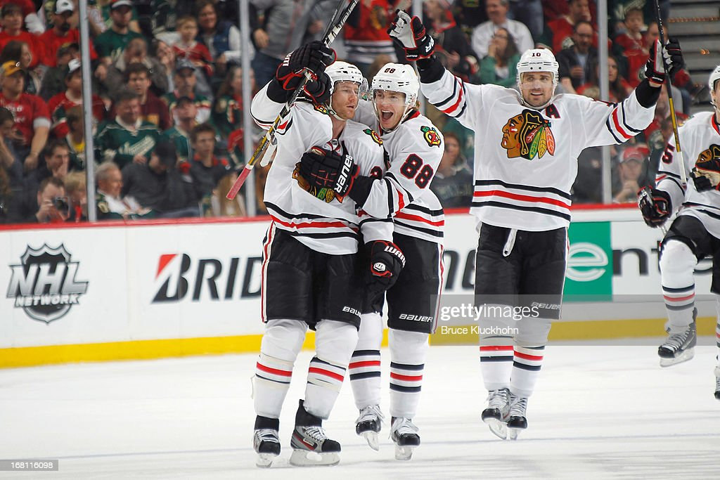 Duncan Keith #2 celebrates with his Chicago Blackhawks teammates Patrick Kane and Patrick Sharp after scoring a goal against the Minnesota Wild in Game Three of the Western Conference Quarterfinals during the 2013 NHL Stanley Cup Playoffs on May 5, 2013 at the Xcel Energy Center in St. Paul, Minnesota.