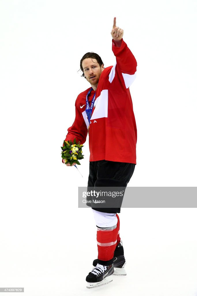 <a gi-track='captionPersonalityLinkClicked' href=/galleries/search?phrase=Duncan+Keith&family=editorial&specificpeople=4194433 ng-click='$event.stopPropagation()'>Duncan Keith</a> #2 of Canada celebrates with his gold medal following his team's 3-0 victory during the Men's Ice Hockey Gold Medal match against Sweden on Day 16 of the 2014 Sochi Winter Olympics at Bolshoy Ice Dome on February 23, 2014 in Sochi, Russia.