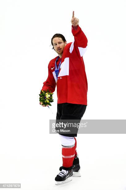 Duncan Keith of Canada celebrates with his gold medal following his team's 30 victory during the Men's Ice Hockey Gold Medal match against Sweden on...