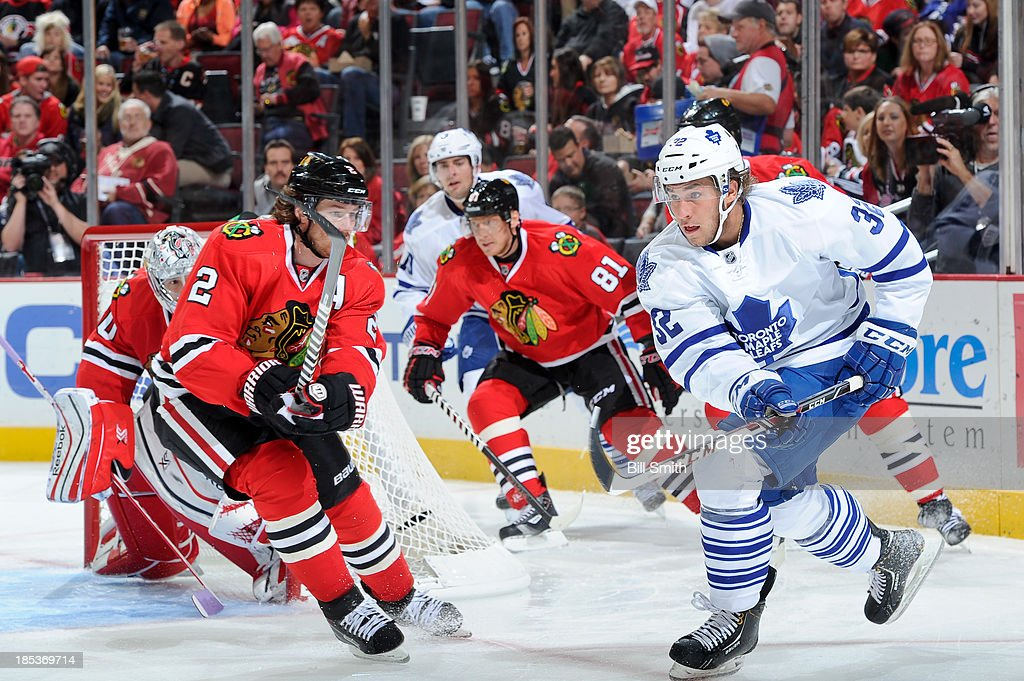 <a gi-track='captionPersonalityLinkClicked' href=/galleries/search?phrase=Duncan+Keith&family=editorial&specificpeople=4194433 ng-click='$event.stopPropagation()'>Duncan Keith</a> #2 of the Chicago Blackhawks and Josh Leivo #32 of the Toronto Maple Leafs skate down the ice during the NHL game on October 19, 2013 at the United Center in Chicago, Illinois.