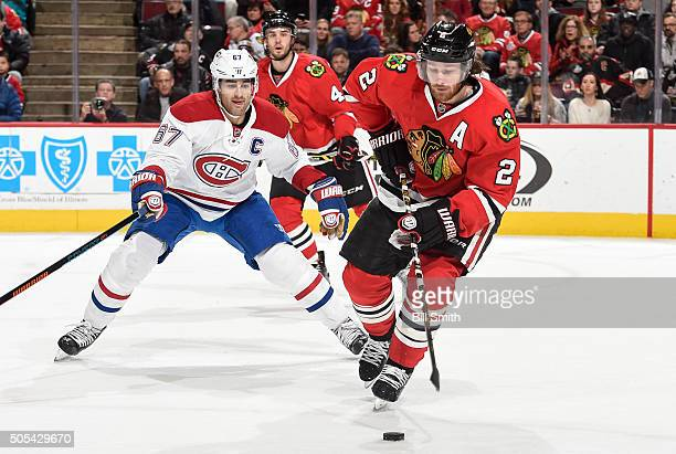 Duncan Keith of the Chicago Blackhawks and Max Pacioretty of the Montreal Canadiens chase the puck in the second period of the NHL game at the United...