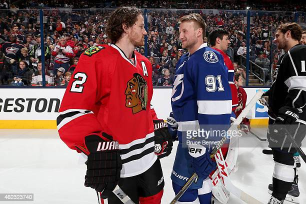 Duncan Keith of the Chicago Blackhawks and Team Foligno talks with Steven Stamkos of the Tampa Bay Lightning and Team Foligno during the AMP NHL...