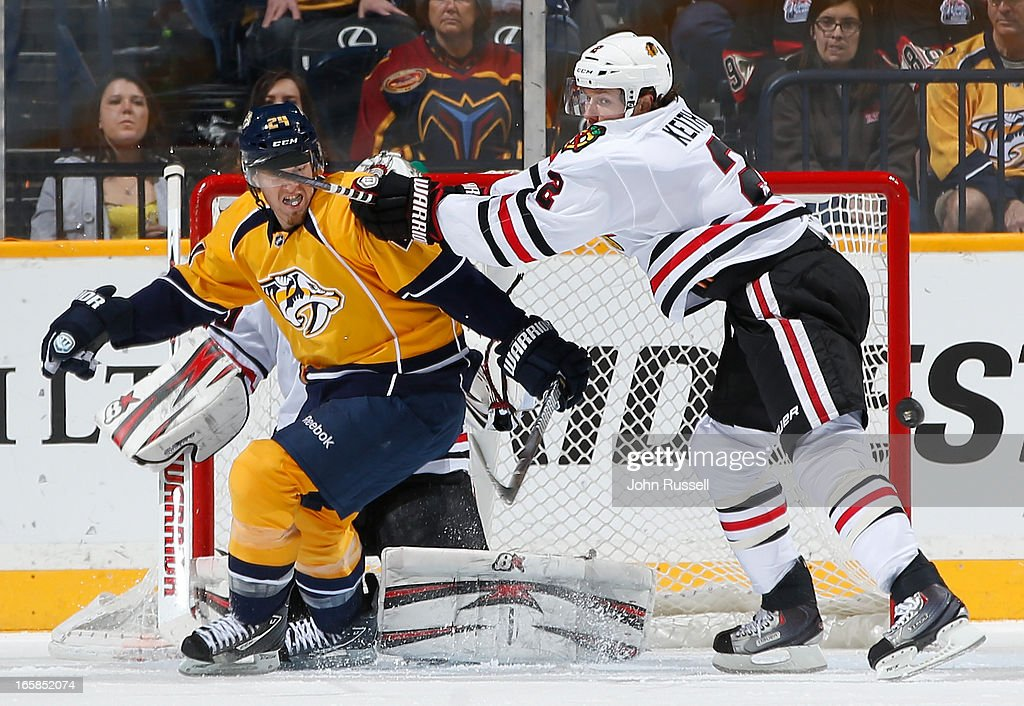 Duncan Keith #2 of the Chicago Blackhawks battles against Matt Halischuk #24 of the Nashville Predators during an NHL game at the Bridgestone Arena on April 6, 2013 in Nashville, Tennessee.