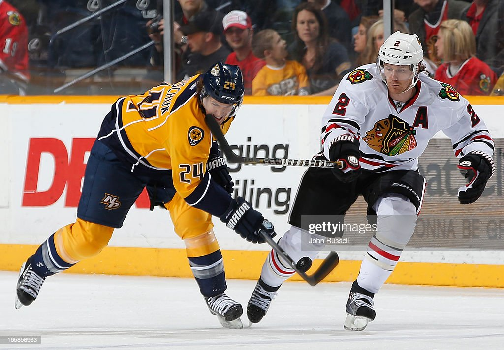 Duncan Keith #2 of the Chicago Blackhawks battles for the puck against Matt Halischuk #24 of the Nashville Predators during an NHL game at the Bridgestone Arena on April 6, 2013 in Nashville, Tennessee.