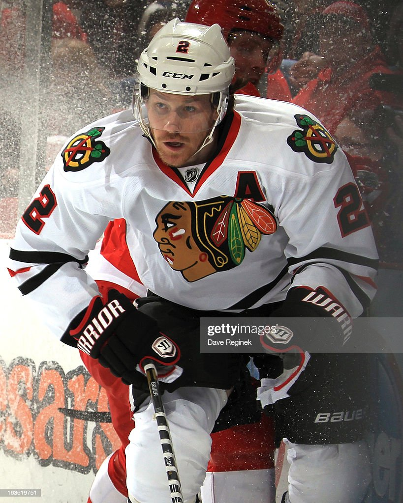 Duncan Keith of the Chicago Blackhawks body checks Dan Cleary of the Detroit Red Wings during an NHL game at Joe Louis Arena on March 3 2013 in...