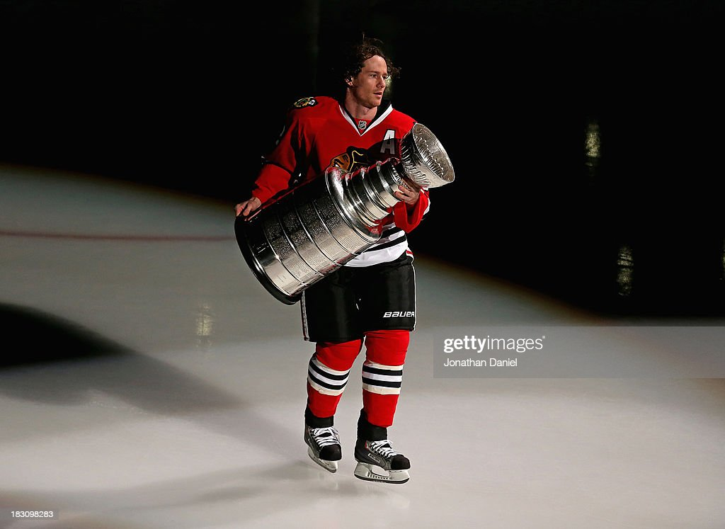 Duncan Keith #2 of the Chicago Blackhawks carries the Stanley Cup one last time during a ceremony before taking on the Washington Capitals at the United Center on October 1, 2013 in Chicago, Illinois. The Blackhawks defeated the Capitals 5-4.