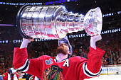 Duncan Keith of the Chicago Blackhawks celebrates by hoisting the Stanley Cup after defeating the Tampa Bay Lightning by a score of 20 in Game Six to...