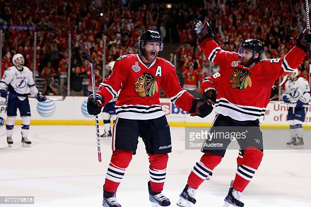 Duncan Keith of the Chicago Blackhawks celebrates his goal with teammate Brandon Saad against the Tampa Bay Lightning in the second period of Game...