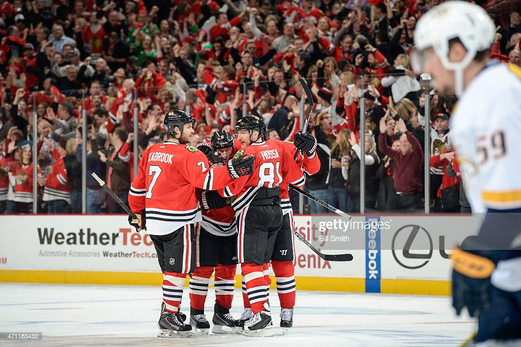 Duncan Keith #2 of the Chicago Blackhawks celebrates with Brent Seabrook #7 and Marian Hossa #81 after scoring against the Nashville Predators in the third period in Game Six of the Western Conference Quarterfinals during the 2015 NHL Stanley Cup Playoffs at the United Center on April 25, 2015 in Chicago, Illinois.