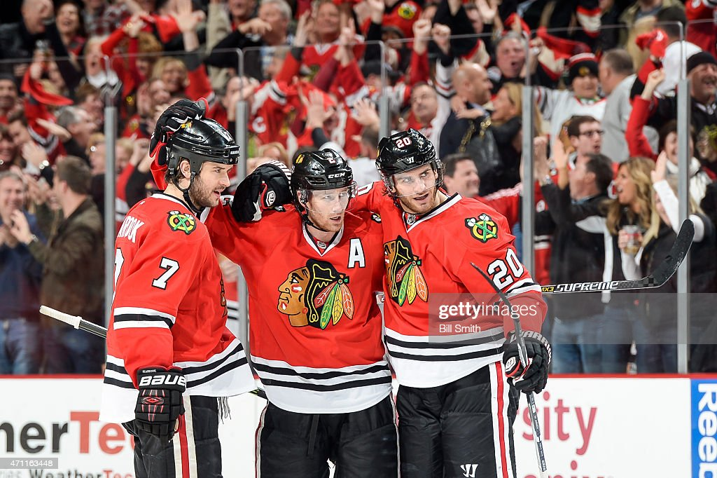 Duncan Keith #2 of the Chicago Blackhawks celebrates with Brent Seabrook #7 and Brandon Saad #20 after scoring against the Nashville Predators in the third period in Game Six of the Western Conference Quarterfinals during the 2015 NHL Stanley Cup Playoffs at the United Center on April 25, 2015 in Chicago, Illinois.