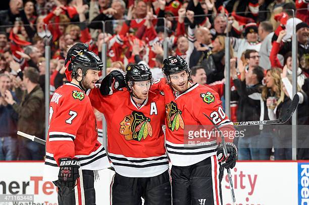 Duncan Keith of the Chicago Blackhawks celebrates with Brent Seabrook and Brandon Saad after scoring against the Nashville Predators in the third...