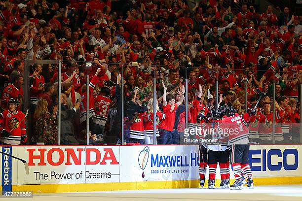 Duncan Keith of the Chicago Blackhawks celebrates with his teammates after scoring a goal in the second period against Ben Bishop of the Tampa Bay...