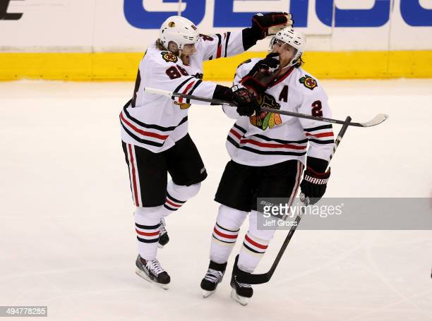 Duncan Keith of the Chicago Blackhawks celebrates with Patrick Kane after Keith scores a third period goal against the Los Angeles Kings in Game Six...
