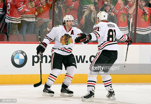 Duncan Keith of the Chicago Blackhawks celebrates with teammate Marian Hossa after his first period goal against the Arizona Coyotes at Gila River...