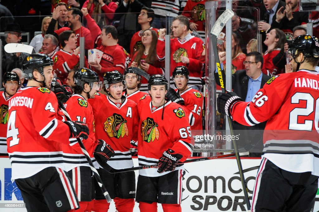 <a gi-track='captionPersonalityLinkClicked' href=/galleries/search?phrase=Duncan+Keith&family=editorial&specificpeople=4194433 ng-click='$event.stopPropagation()'>Duncan Keith</a> #2 of the Chicago Blackhawks (middle) celebrates with teammates <a gi-track='captionPersonalityLinkClicked' href=/galleries/search?phrase=Niklas+Hjalmarsson&family=editorial&specificpeople=2006442 ng-click='$event.stopPropagation()'>Niklas Hjalmarsson</a> #4, <a gi-track='captionPersonalityLinkClicked' href=/galleries/search?phrase=Patrick+Sharp&family=editorial&specificpeople=206279 ng-click='$event.stopPropagation()'>Patrick Sharp</a> #10, Andrew Shaw #65 and <a gi-track='captionPersonalityLinkClicked' href=/galleries/search?phrase=Michal+Handzus&family=editorial&specificpeople=201537 ng-click='$event.stopPropagation()'>Michal Handzus</a> #26 after scoring against the Dallas Stars in the second period during the NHL game on March 25, 2014 at the United Center in Chicago, Illinois.