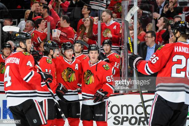 Duncan Keith of the Chicago Blackhawks celebrates with teammates Niklas Hjalmarsson Patrick Sharp Andrew Shaw and Michal Handzus after scoring...