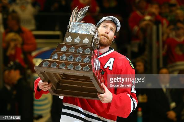 Duncan Keith of the Chicago Blackhawks celebrates with the Conn Smythe trophy after defeating the Tampa Bay Lightning by a score of 20 in Game Six to...
