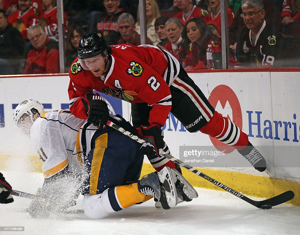 Duncan Keith #2 of the Chicago Blackhawks knocks down Taylor Beck #41 of the Nashville Predators and steals the puck in Game Six of the Western Conference Quarterfinals during the 2015 NHL Stanley Cup Playoffs at the United Center on April 25, 2015 in Chicago, Illinois.