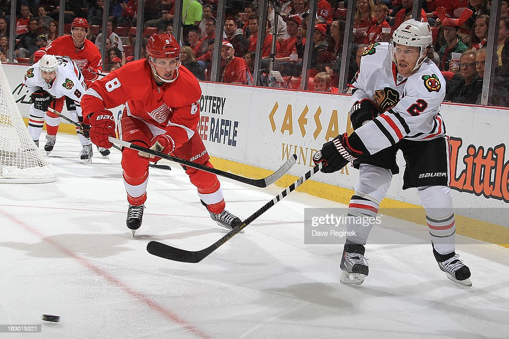<a gi-track='captionPersonalityLinkClicked' href=/galleries/search?phrase=Duncan+Keith&family=editorial&specificpeople=4194433 ng-click='$event.stopPropagation()'>Duncan Keith</a> #2 of the Chicago Blackhawks passes the puck in front of <a gi-track='captionPersonalityLinkClicked' href=/galleries/search?phrase=Justin+Abdelkader&family=editorial&specificpeople=2271858 ng-click='$event.stopPropagation()'>Justin Abdelkader</a> #8 of the Detroit Red Wings during an NHL game at Joe Louis Arena on March 3, 2013 in Detroit, Michigan.