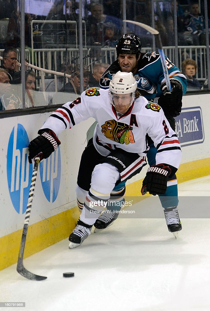 Duncan Keith #2 of the Chicago Blackhawks skates to gain control of the puck in front of Ryane Clowe #29 of the San Jose Sharks in the first period of their game at HP Pavilion on February 5, 2013 in San Jose, California. The Blackhawks won the game 5-3.