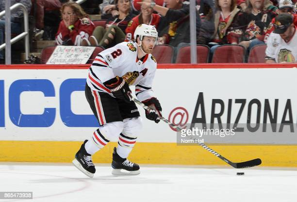 Duncan Keith of the Chicago Blackhawks skates with the puck against the Arizona Coyotes at Gila River Arena on October 21 2017 in Glendale Arizona