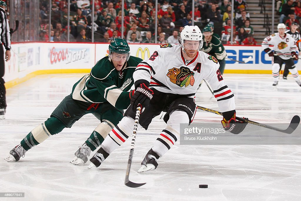 Duncan Keith #2 of the Chicago Blackhawks skates with the puck while Charlie Coyle #3 of the Minnesota Wild defends during Game Four of the Second Round of the 2014 Stanley Cup Playoffs on May 9, 2014 at the Xcel Energy Center in St. Paul, Minnesota.