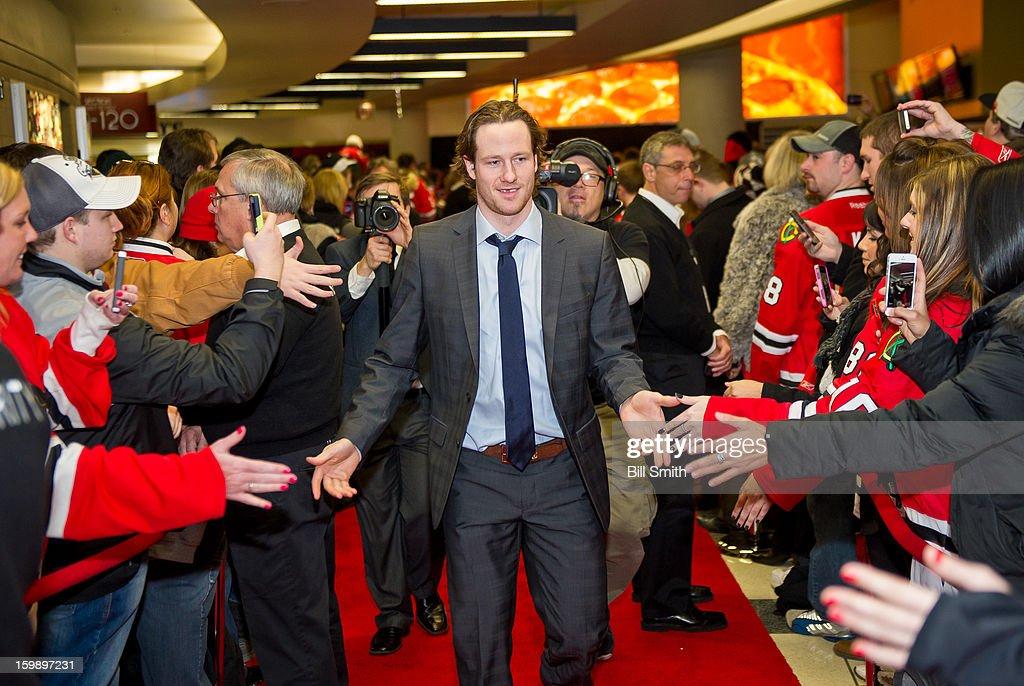 Duncan Keith #2 of the Chicago Blackhawks slaps hands with fans before the NHL game against the St. Louis Blues on January 22, 2013 at the United Center in Chicago, Illinois.