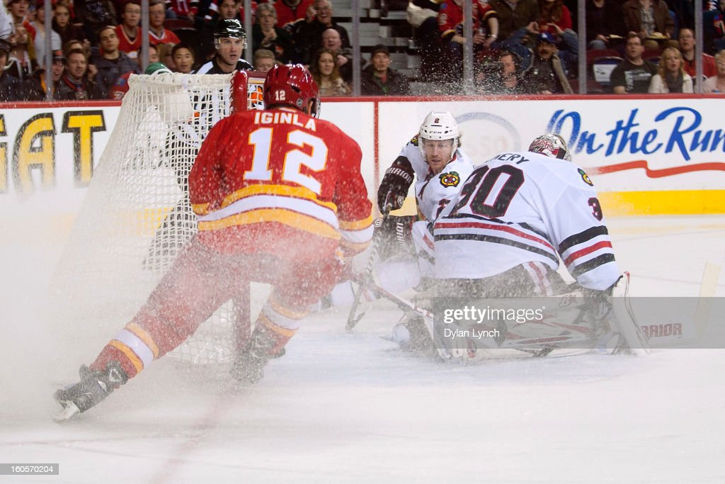 Duncan Keith #2 of the Chicago Blackhawks slides past the net while looking for a rebound during a game against the Calgary Flames at Scotiabank Saddledome on February 2, 2013 in Calgary, Alberta, Canada.