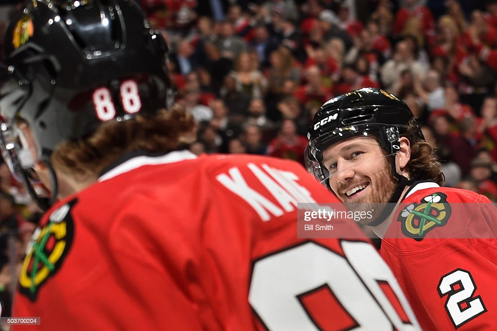 <a gi-track='captionPersonalityLinkClicked' href=/galleries/search?phrase=Duncan+Keith&family=editorial&specificpeople=4194433 ng-click='$event.stopPropagation()'>Duncan Keith</a> #2 of the Chicago Blackhawks smiles at Patrick Kane #88 after the Blackhawks scored against the Pittsburgh Penguins in the first period of the NHL game at the United Center on January 6, 2016 in Chicago, Illinois.