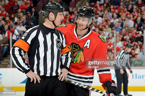 Duncan Keith of the Chicago Blackhawks talks with referee Chris Lee in Game Five of the Western Conference Quarterfinals against the Minnesota Wild...