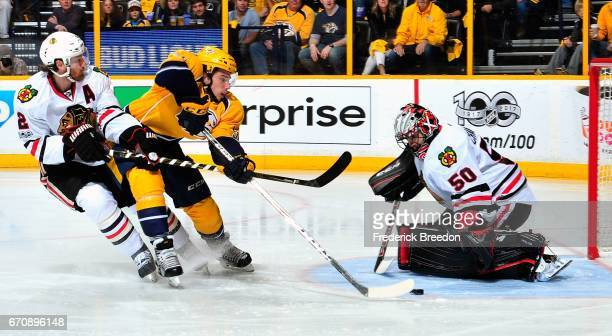 Duncan Keith of the Chicago Blackhawks ties up the stick of Kevin Fiala of the Nashville Predators during the first period in Game Four of the...