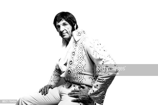 Duncan Mckellar A Tractor Combine Operator from Andover Hampshire poses in a portrait studio during the World's largest gathering of Elvis Presley...