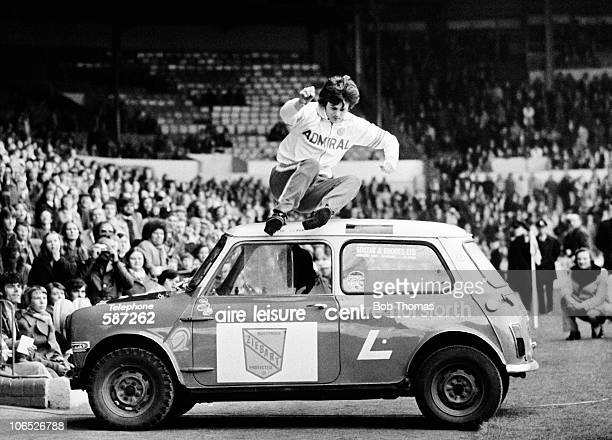 Duncan McKenzie of Leeds United jumps over a Mini as part of the prematch entertainment before the Paul Reaney Testimonial match against Newcastle...