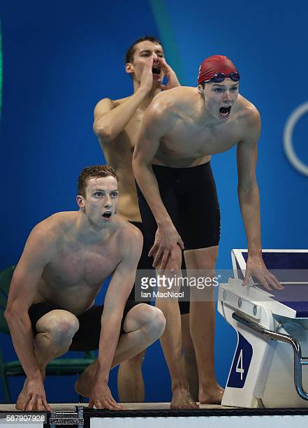 Duncan Scott Dan Wallace and Stephen Milne of Great Britain react during the Men's 4 x 200m Freestyle Relay on Day 4 of the Rio 2016 Olympic Games at...