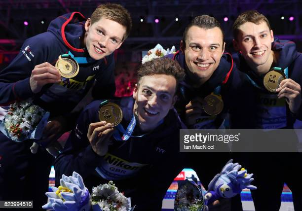 Duncan Scott James Guy Nicholas Grainger and Stephen Milne pose with their medals after Great Britain win the 4 x 200m Freestyle Relay during day...