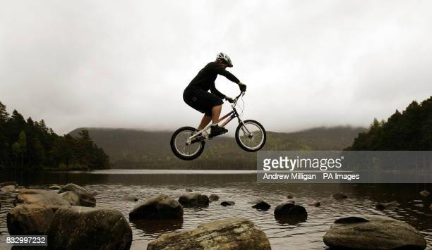 Duncan Shaw shows his skills by hopping between stones on the shores of Lochan Eilein in preparation for the Outside Festival midsummer weekend in...