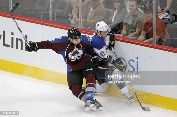 Duncan Siemens of the Colorado Avalanche and Ty Rattie of the St Louis Blues collide on the boards as they pursue the puck during their preseason...