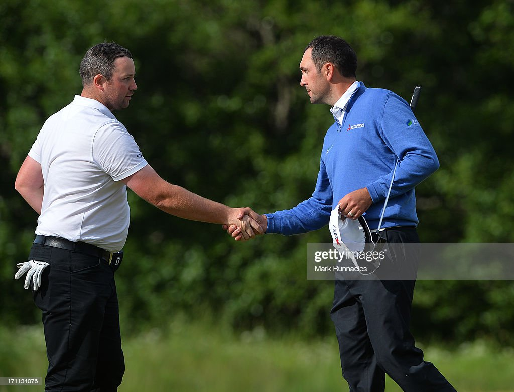 Duncan Stewart of Scotland (L) and Jack Doherty of Scotland shake hands at the 18th during the Third Round of the Scottish Hydro Challenge hosted by MacDonald Hotels & Resorts on June 22, 2013 in Aviemore, Scotland.