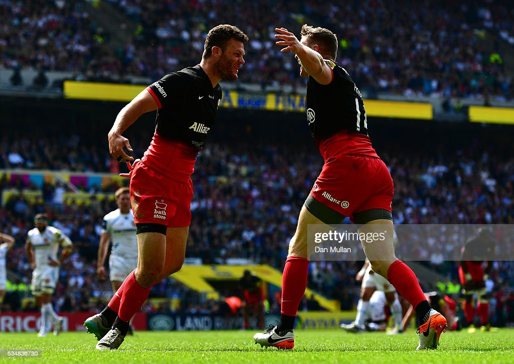 Duncan Taylor of Saracens celebrates scoring his team's first try with Chris Ashton of Saracens during the Aviva Premiership final match between Saracens and Exeter Chiefs at Twickenham Stadium on May 28, 2016 in London, England.