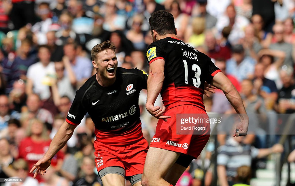 Duncan Taylor of Saracens celebrates scoring his team's first try with <a gi-track='captionPersonalityLinkClicked' href=/galleries/search?phrase=Chris+Ashton&family=editorial&specificpeople=2649431 ng-click='$event.stopPropagation()'>Chris Ashton</a> of Saracens during the Aviva Premiership final match between Saracens and Exeter Chiefs at Twickenham Stadium on May 28, 2016 in London, England.