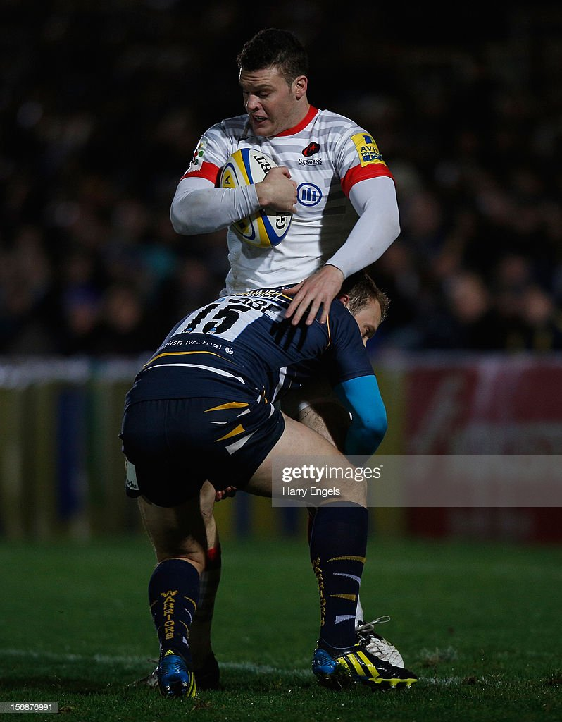 Duncan Taylor of Saracens is tackled by Worcester fullback Chris Pennell during the Aviva Premiership match between Worcester Warriors and Saracens at Sixways Stadium on November 23, 2012 in Worcester, England.