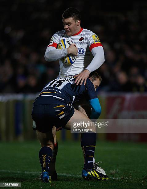Duncan Taylor of Saracens is tackled by Worcester fullback Chris Pennell during the Aviva Premiership match between Worcester Warriors and Saracens...