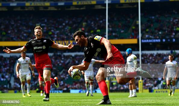 Duncan Taylor of Saracens scores his team's first try with Chris Ashton of Saracens during the Aviva Premiership final match between Saracens and...